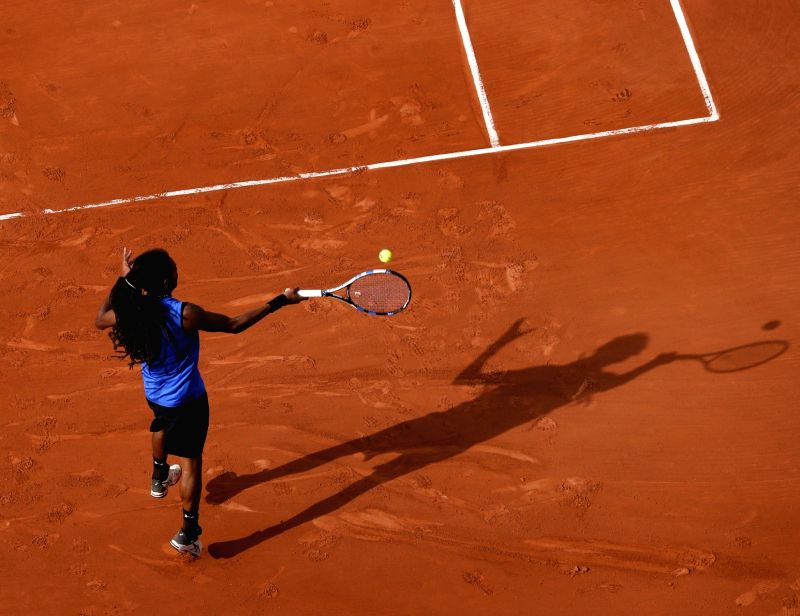 PARIS, May 31, 2017 - Dustin Brown of Germany returns the ball during the men's singles first round match with Gael Monfils of France at French Open Tennis Tournament 2017 in Roland Garros, Paris, ...