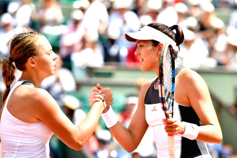 PARIS, May 31, 2017 - Garbine Muguruza (R) of Spain greets Anett Kontaveit of Estonia after the women's singles 2nd round match at the French Open Tennis Tournament 2017 in Paris, France on May 31, ...