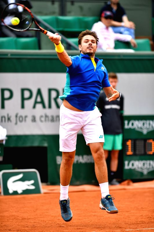 PARIS, May 31, 2017 - Stan Wawrinka of Switzerland returns the ball to Jozef Kovalik of Slovakia during their men's singles 1st round match at French Open Tennis Tournament 2017 in Paris, France on ...