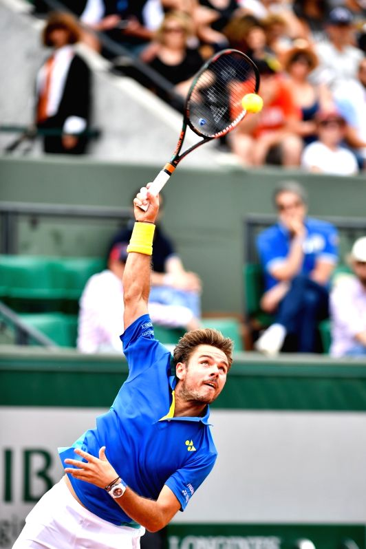 PARIS, May 31, 2017 - Stan Wawrinka of Switzerland serves to Jozef Kovalik of Slovakia during their men's singles 1st round match at French Open Tennis Tournament 2017 in Paris, France on May 30, ...
