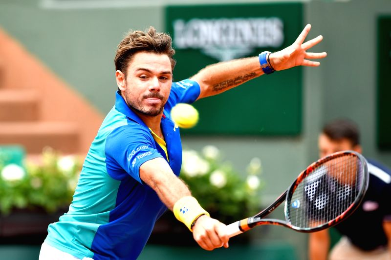 PARIS, May 31, 2017 - Stan Wawrinka of Switzerland returns the ball to Jozef Kovalik of Slovakia during the men's singles 1st round match at French Open Tennis Tournament 2017 in Paris, France on May ...
