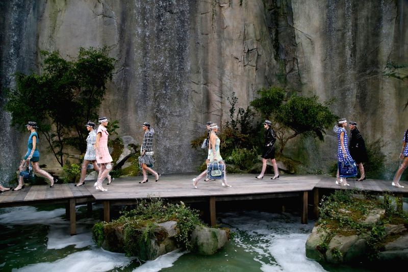 PARIS, Oct. 3, 2017 - Models present creations of Chanel during the fashion week for 2018 spring/summer women's collection in Paris, France, on Oct. 3, 2017.