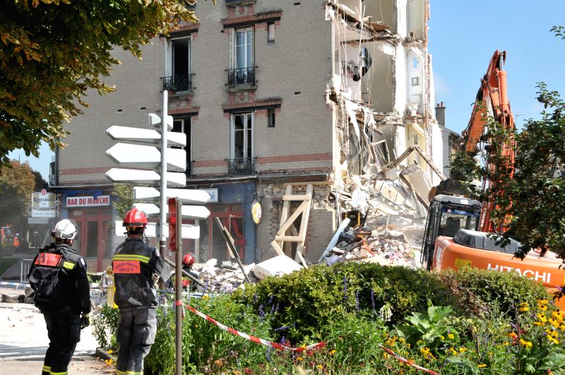 Rescuers work at the site of a building collapse in Rosny-sous-Bois, France, Sept. 1, 2014. At least seven people were killed in a building collapse in ...