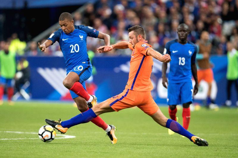 PARIS, Sept. 1, 2017 - Kylian Mbappe (L) of France vies with Stefan de Vrij of Netherlands during the 2018 World Cup European Qualifier at Stades de France in Paris, France on Aug. 31, 2017. France ...