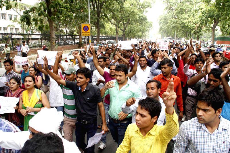 Part-time teachers demonstrate near Shastri Bhawan in New Delhi on July 1, 2014.