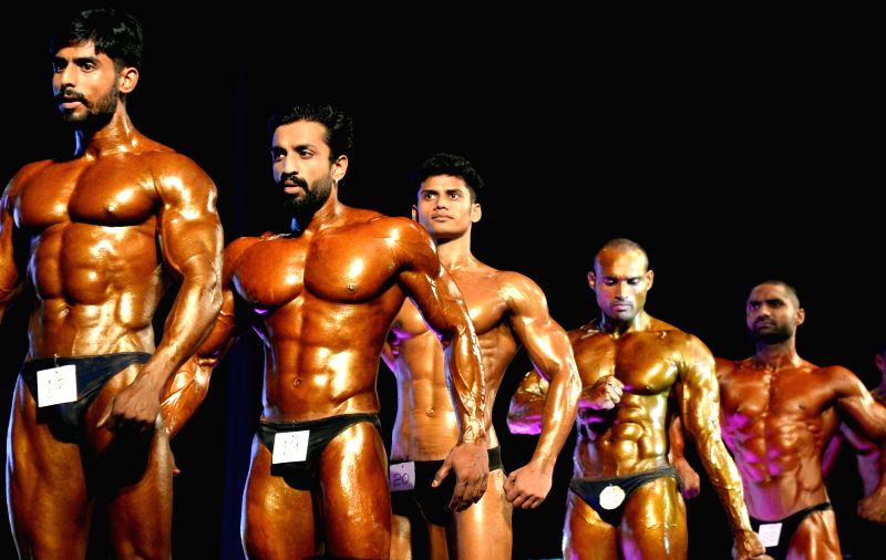 Participants of 65th National Body Building Championship strike a pose in Bengaluru on May 13, 2017.
