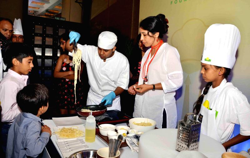 Participants of `Cook for a Smile` in New Delhi on July 27, 2014.