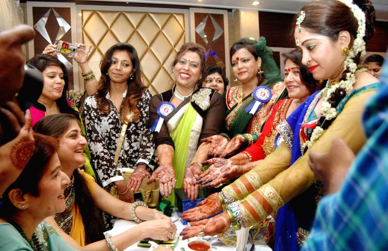 Participants of Sawan Milan programme at a hotel in Patna on July 18, 2014.