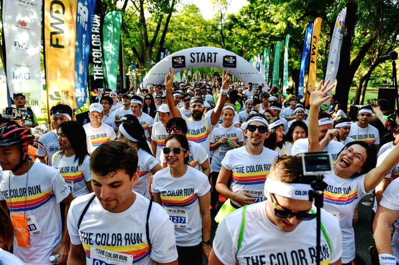 Participants of the Color Run Bangkok set off from the start line at the Suan Rod Fai park in Bangkok, Thailand, Oct. 31, 2015. The Color Run is a 5km public paint ...