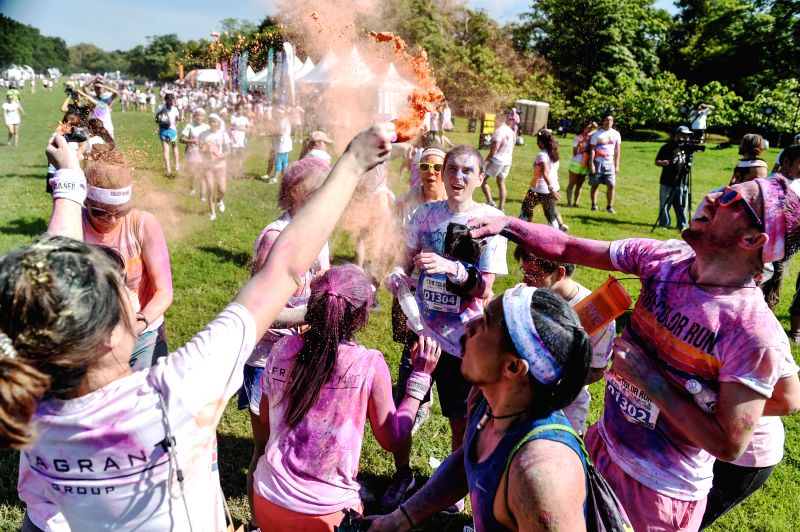 Participants of the Color Run Bangkok throw colored powders at each other at the Suan Rod Fai park in Bangkok, Thailand, Oct. 31, 2015. The Color Run is a 5km ...