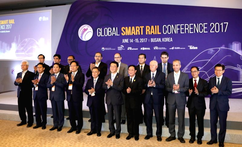 Participants pose at the opening ceremony of the 2017 Global Smart Rail Conference at a convention center in Busan on June 14, 2017, on the sidelines of the 2017 RailLog Korea, one of the world's ...