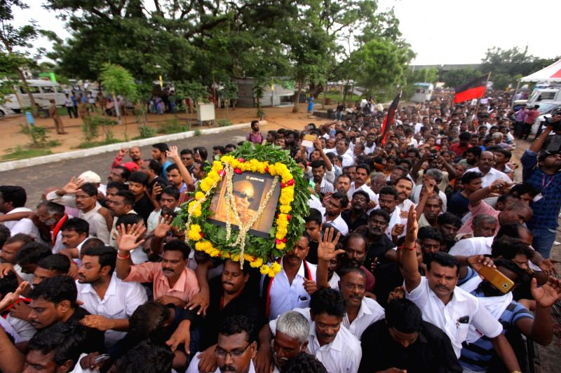 Party supporters wait to pay last respect to DMK patriarch M. Karunanidhi in Chennai on Aug 8, 2018.
