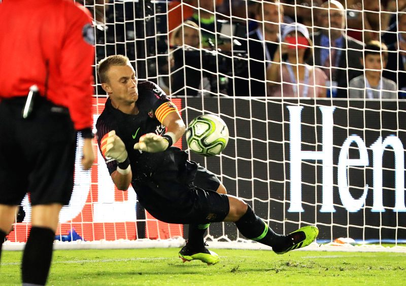 PASADENA, July 29, 2018 - Barcelona's goalkeeper Jasper Cillessen (R) blocks during the International Champions Cup soccer match between Barcelona and Tottenham Hotspur in Pasadena, the United ...