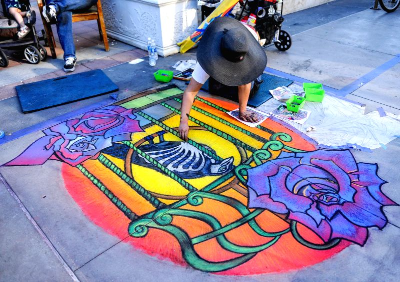 PASADENA, June 20, 2016 - An artist paints on the 24th annual Pasadena Chalk Festival in Pasadena in Los Angeles, June 19, 2016. The festival featured hundreds of works by more than 600 chalk artists ...