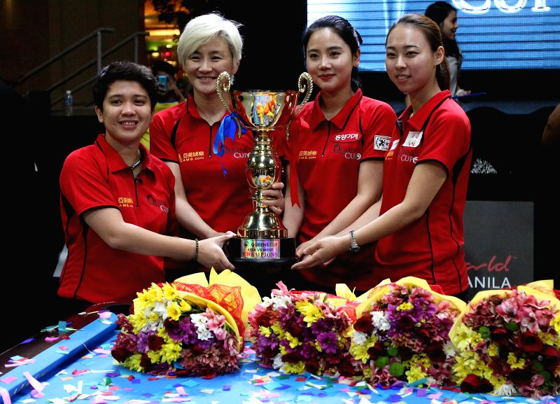 The East team, consisting of Rubilen Amit of the Philippines, Jennifer Chen of Chinese Taipei, Eunji Park of South Korea and Chen Siming of China (L to R) hold ...