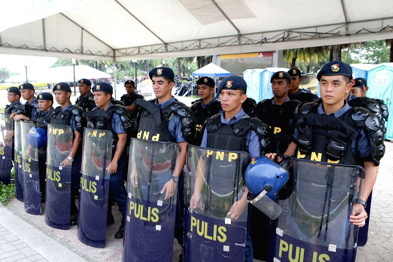 PASAY CITY, April 27, 2017 - Policemen wearing anti-riot gear stand by near the Philippine International Convention Center (PICC), the venue for this year's Association of Southeast Asian Nations ...