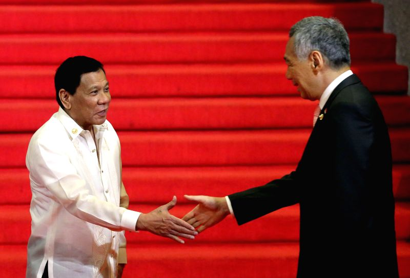 PASAY CITY, April. 29, 2017 - Philippine President Rodrigo Duterte (L) greets Singapore Prime Minister Lee Hsien Loong at the Reception Hall of the Philippine International Convention Center (PICC) ... - Lee Hsien Loong