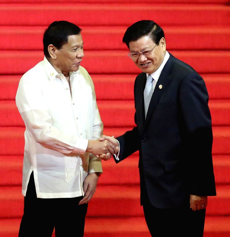 PASAY CITY, April. 29, 2017 - Philippine President Rodrigo Duterte (L) greets Laos Prime Minister Thongloun Sisoulith at the Reception Hall of the Philippine International Convention Center (PICC) ... - Thongloun Sisoulith