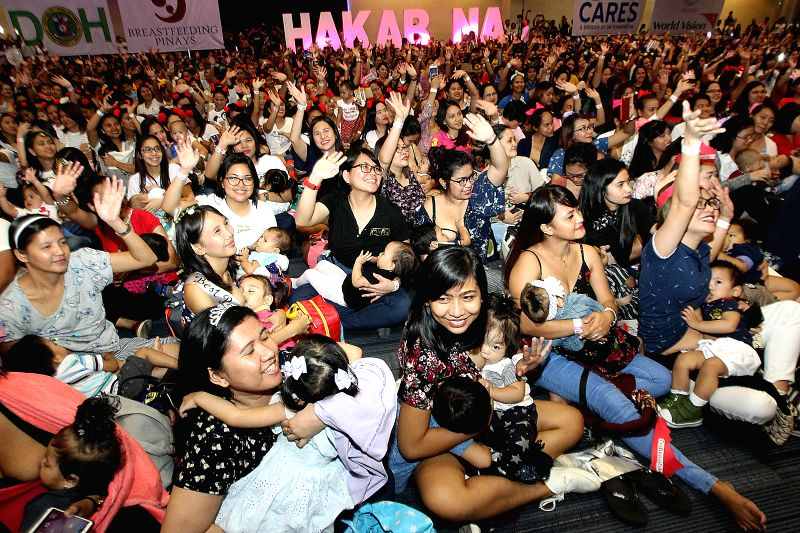"PASAY CITY, Aug. 5, 2018 - Mothers breastfeed their babies during the ""Hakab Na! 2018"" breastfeeding event in Pasay City, the Philippines, Aug. 5, 2018. More than 2,000 mothers participated ..."