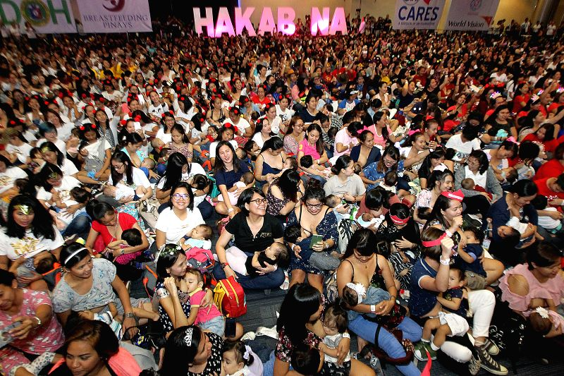 """PASAY CITY, Aug. 5, 2018 - Mothers breastfeed their babies during the """"Hakab Na! 2018"""" breastfeeding event in Pasay City, the Philippines, Aug. 5, 2018. More than 2,000 mothers participated ..."""