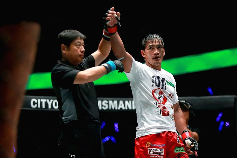 PASAY CITY, July 28, 2018 - Eduard Folayang (R) of the Philippines celebrates after winning against Aziz Pahrudinov of Russia in the One Championship in Pasay City,?the?Philippines, July 27, 2018. ...