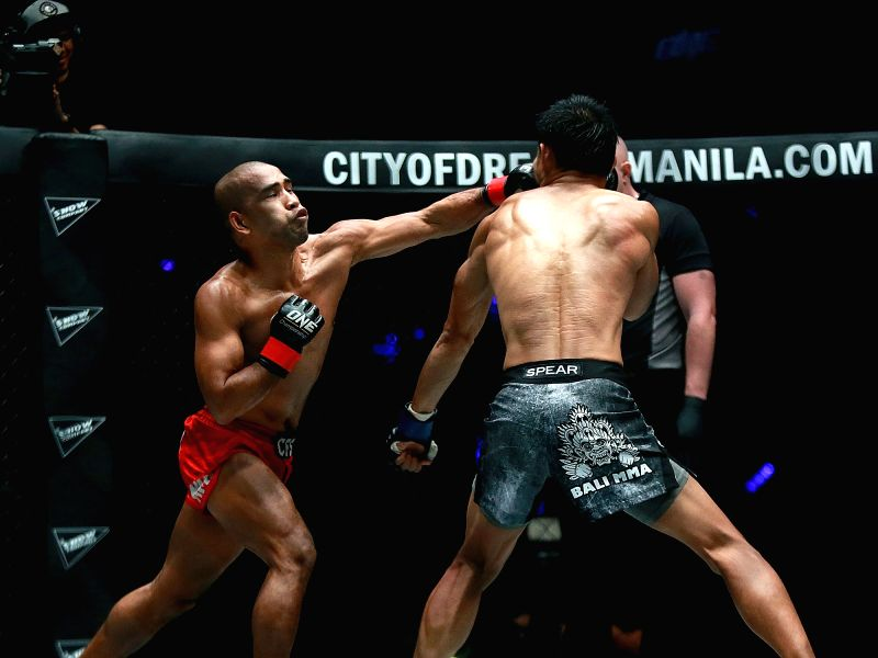 PASAY CITY, July 28, 2018 - Rene Catalan (L) of the Philippines competes against Stefer Rahardian of Indonesia during their strawweight match in the One Championship in Pasay City, the Philippines, ...