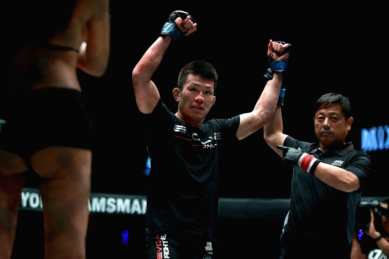 PASAY CITY, July 28, 2018 - Shinya Aoki (C) of Japan celebrates after winning against Shannon Wiratchai of Thailand during their lightweight match in the One Championship in Pasay City, the ...
