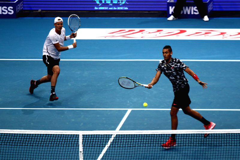 Pasay City (Philippines): DBS Singapore Slammers players Tomas Berdych (L) of Czech Republic and Nick Kyrgios of Australia compete during their men's doubles match against Micromax Indian Aces in the