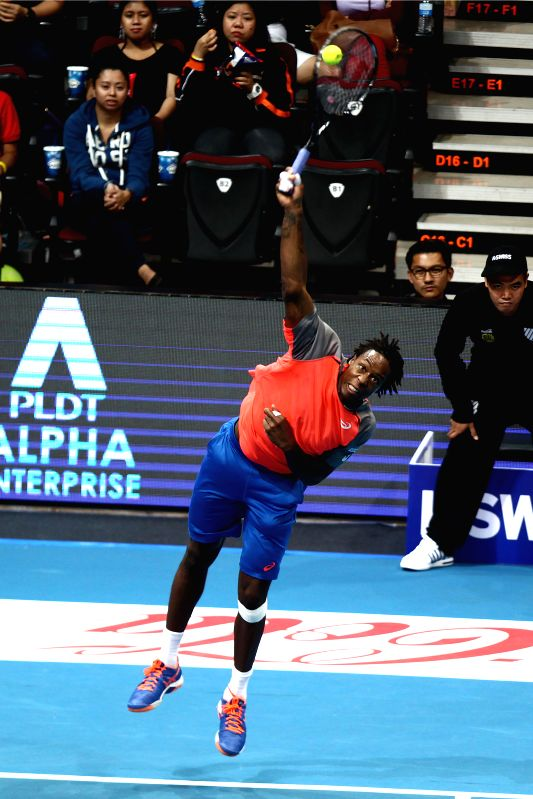 Pasay City (Philippines): Gael Monfils of France, a player of Team Micromax Indian Aces, serves to Lleyton Hewitt of Australia, a player of Team DBS Singapore Slammers, during a match between Team ...