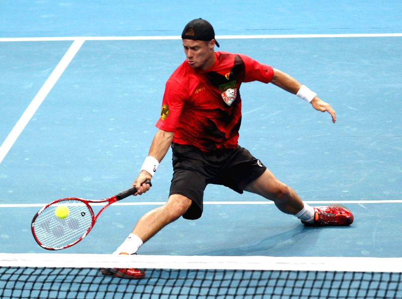 Pasay City (Philippines): Lleyton Hewitt of Australia, a player of Team DBS Singapore Slammers, returns the ball to Gael Monfils of France, a player of Team Micromax Indian Aces, during a match ...
