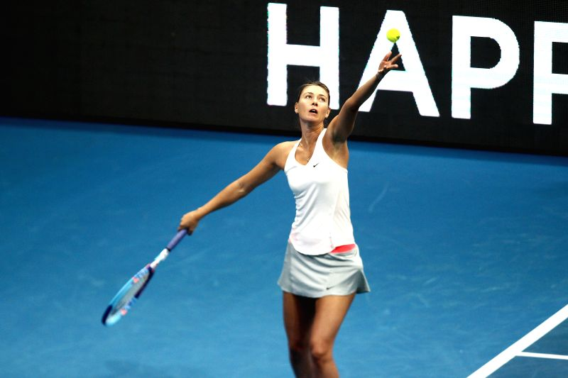 Pasay City (Philippines):Manila Mavericks player Maria Sharapova of Russia hits a return against the Micromax Indian Aces players Rohan Bopanna and Sania Mirza of India during her mixed doubles match - Rohan Bopanna and Sania Mirza