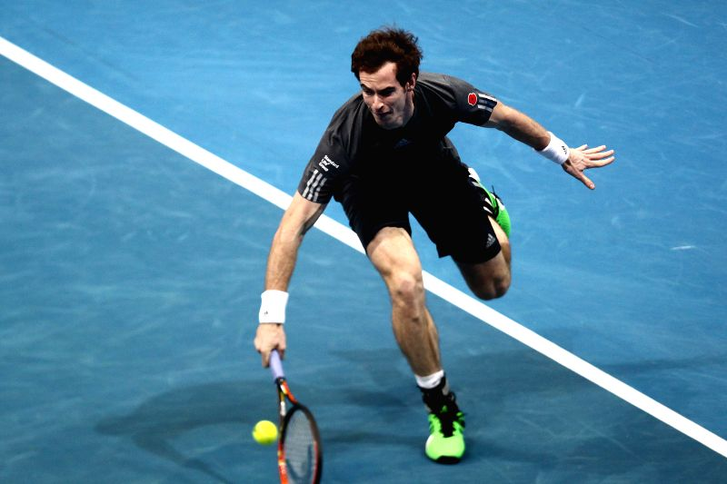 Pasay City (Philippines):Manila Mavericks player Andy Murray of Great Britain returns the ball against Micromax Indian Aces player Gael Monfils of France during their match in the International ...