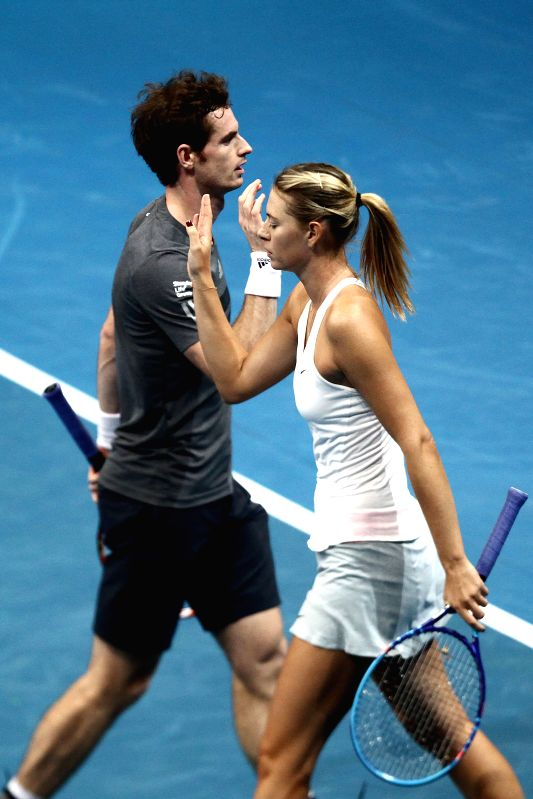 Pasay City (Philippines):Manila Mavericks players Maria Sharapova (R) of Russia and Andy Murray of Great Britain react during their mixed doubles match against the Micromax Indian Aces players Rohan . - Rohan Bopanna and Sania Mirza
