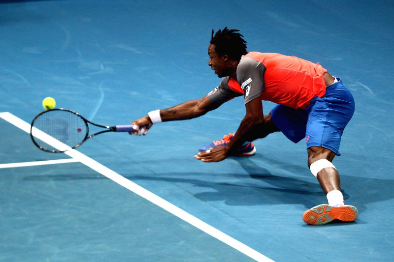 Pasay City (Philippines):Micromax Indian Aces player Gael Monfils of France returns the ball against Manila Mavericks player Andy Murray of Great Britain during their match in the International ...