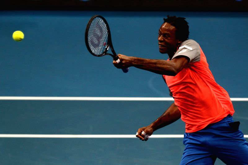 Pasay City (Philippines): Micromax Indian Aces player Gael Monfils of France returns the ball against UAE Royals player Marin Cilic of Croatia during their men's singles match in the International ...