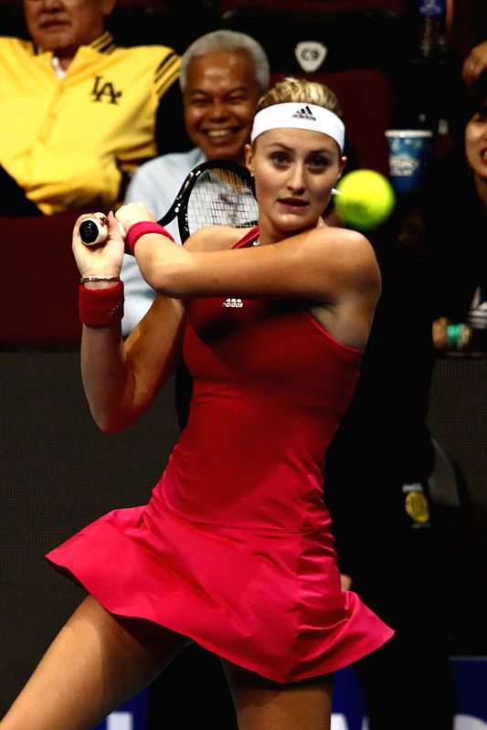Pasay City (Philippines): UAE Royals player Kristina Mladenovic of France returns the ball against DBS Singapore Slammers during their mixed doubles match in the International Premier Tennis League ..