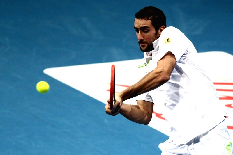 Pasay City (Philippines): UAE Royals player Marin Cilic of Croatia returns the ball against Micromax Indian Aces player Gael Monfils of France during their men's singles match in the International ...
