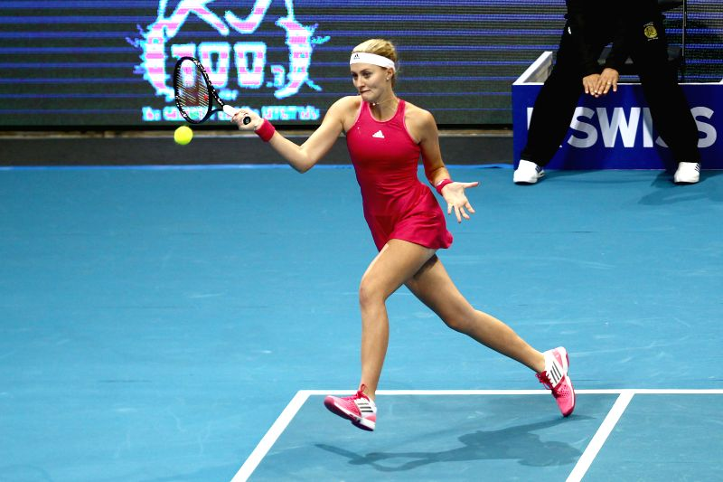 Pasay City (Philippines): United Arab Emirates Royals player Kristina Mladenovic of France returns the ball with Nenad Zimonjic of Serbia during their mixed doubles match against Manila Mavericks ...