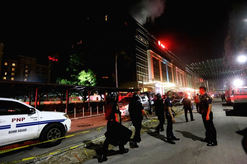 PASAY CITY (THE PHILIPPINES), June 2, 2017 Police officers secure the surroundings of Resorts World Manila after an attack in Pasay City, the Philippines, on June 2, 2017. Unidentified ...