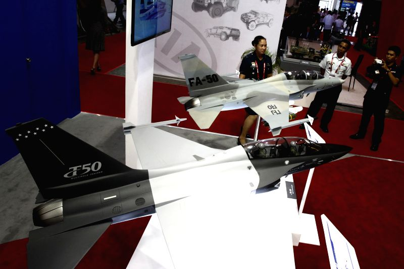 Miniature aircrafts from South Korea are seen during the Asian Defence and Security (ADAS) Exhibition 2014 in Pasay City, the Philippines, on July 17, 2014. More than