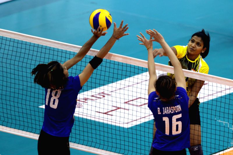 India's Muraleedharan Shyamala Poornima (R) spikes the ball during the match against Thailand at the 1st Asian U-23 Women's Volleyball Championship in Pasig City, ...