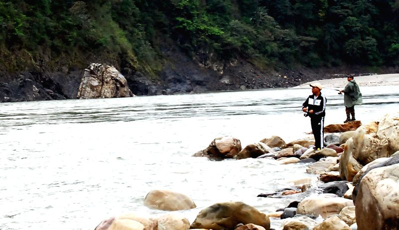 Locals participate in the Angling Competition on Siang River held during 1st Arunachal Spring Carnival in Pasighat, East Siang district of Arunachal Pradesh on March 18, 2015.