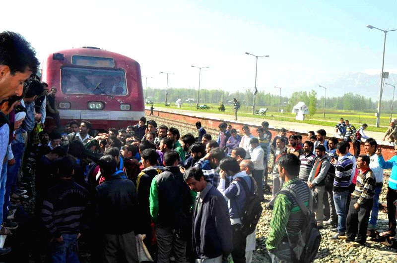 Passengers disrupt Banihal - Baramullah train service to protest against overcrowding in trains in Anantnag district of Jammu and Kashmir on April 28, 2014. Frequent traffic jams and sorry state of ..