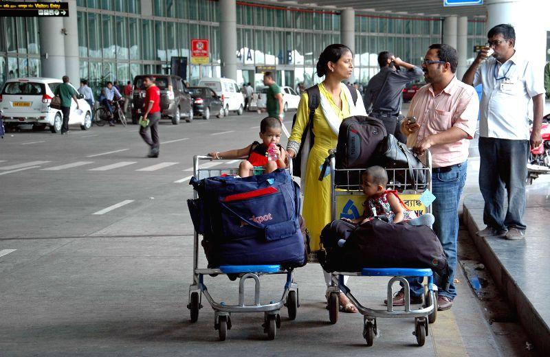 Passengers inconvenienced at Netaji Subhash Chandra Bose Airport as taxi drivers go on a strike in Kolkata on Sept 3, 2014.