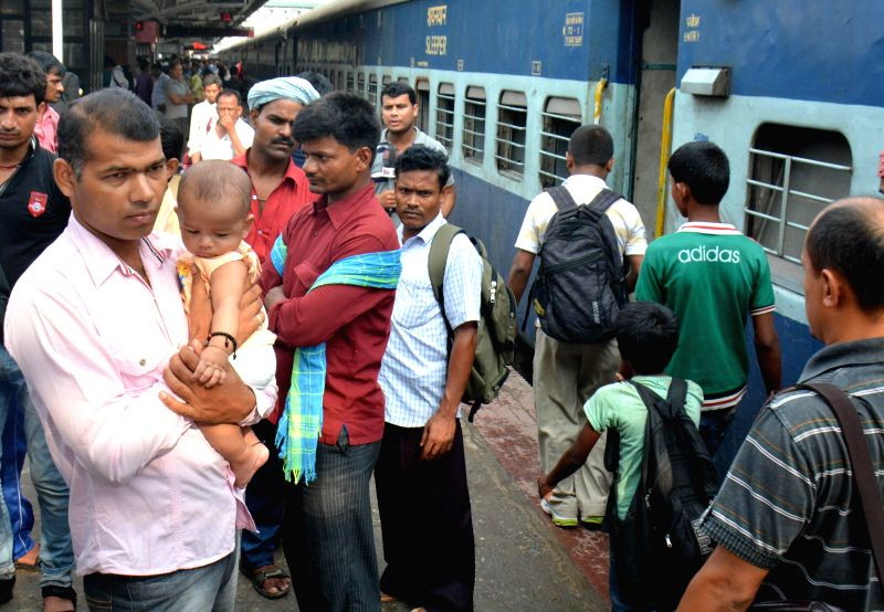 Passengers of Delhi-Dibrugarh Rajdhani Express which got derailed near Goldenganj railway station in Bihar's Saran district on 25th June, 2014 arrive at Guwahati railway station in a special train on
