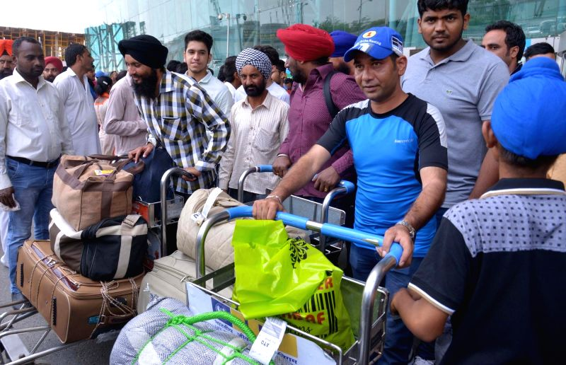 Passengers of Dubai-Amritsar coming out from the Airport after an unclaimed bag was found at the international airport from SpiceJet's Dubai-Amritsar flight in Amritsar on July 21, 2016.