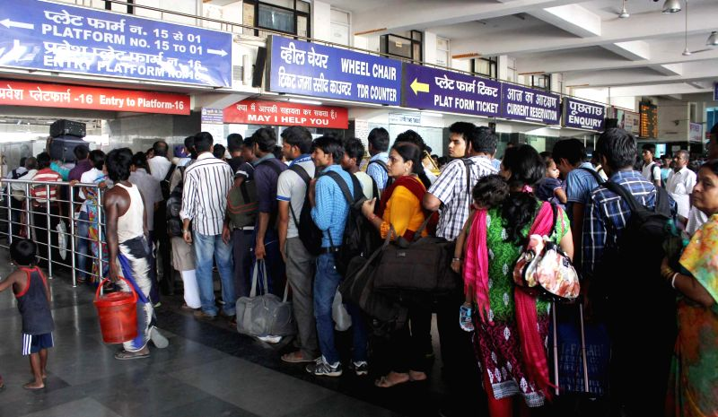 Passengers stand in a serpentine queue at New Delhi Railway Station as Union Railway Minister D.V. Sadananda Gowda presents rail budget 2014-15 in the Parliament on July 8, 2014. - D.