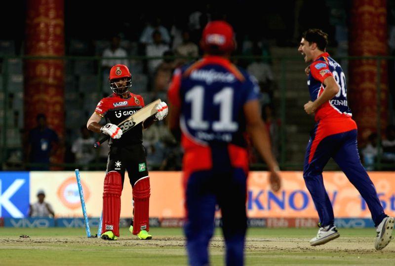 Pat Cummins of Delhi Daredevils celebrates fall of Vishnu Vinod's wicket during an IPL 2017 match between Delhi Daredevils and Royal Challengers Bangalore at Feroz Shah Kotla Ground in New ...