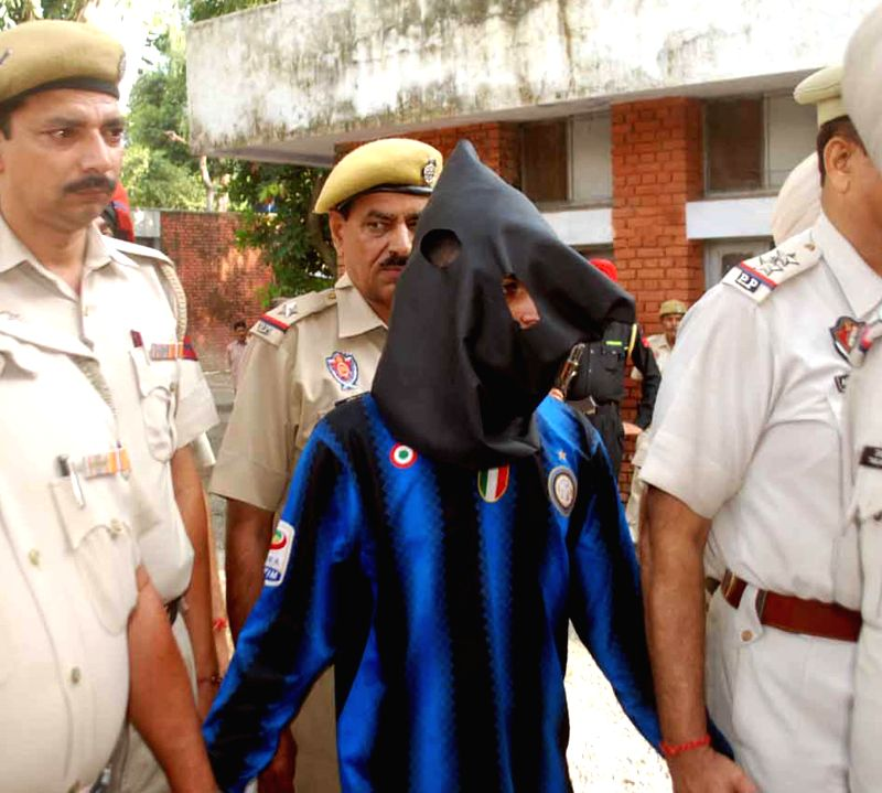Pathankot police presents before press an alleged spy who reportedly used to share sensitive information in lieu of money with a woman whom he befriended on a social networking site, in Pathankot on .