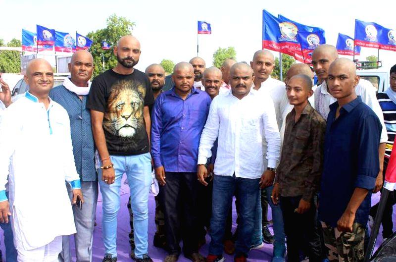 Patidar Anamat Andolan Samiti (PAAS) convener Hardik Patel who along with 51 others got his head tonsured stages a demonstration against Gujarat Government in Bhavnagar of Gujarat on May ... - Hardik Patel